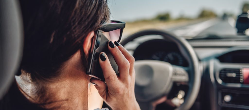 Tougher rules slash mobile phone driving offences